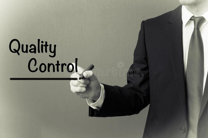 Business man writing - Quality Control stock image