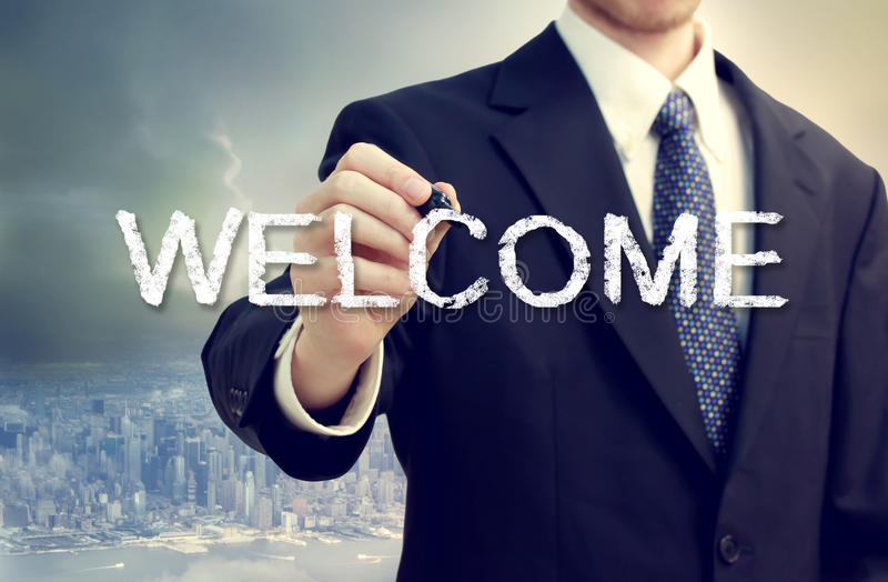 Business man writing WELCOME royalty free stock photos