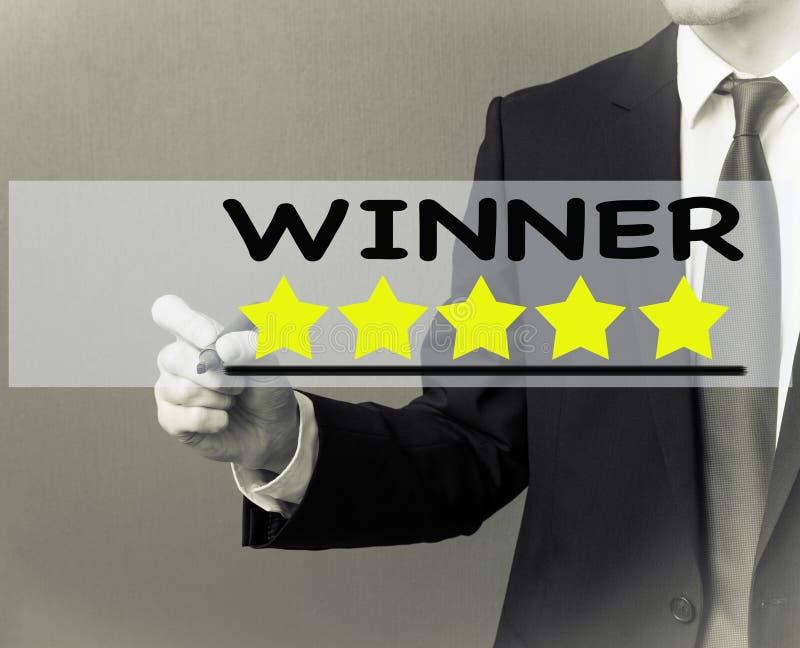 Business man writing - Winner rating stars royalty free stock photos