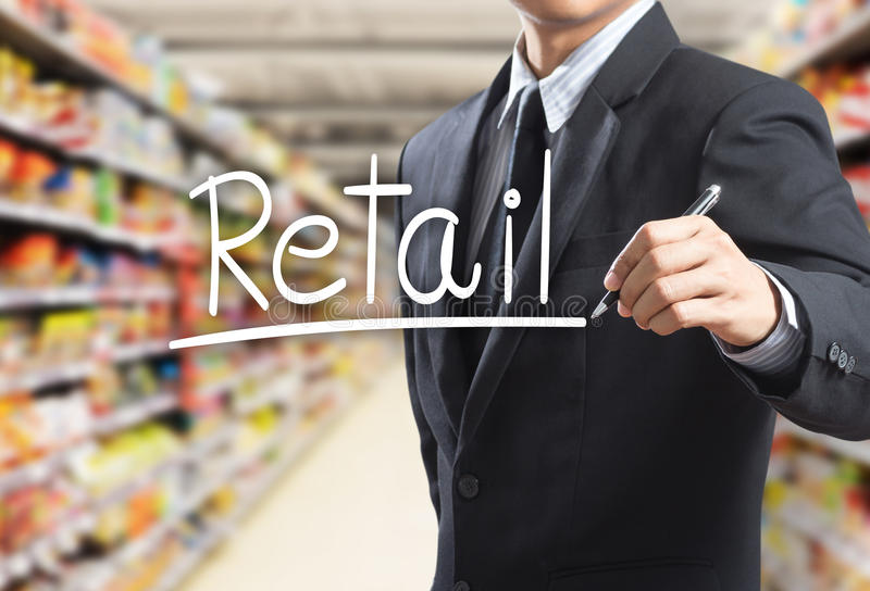 Business man writing word retail stock images