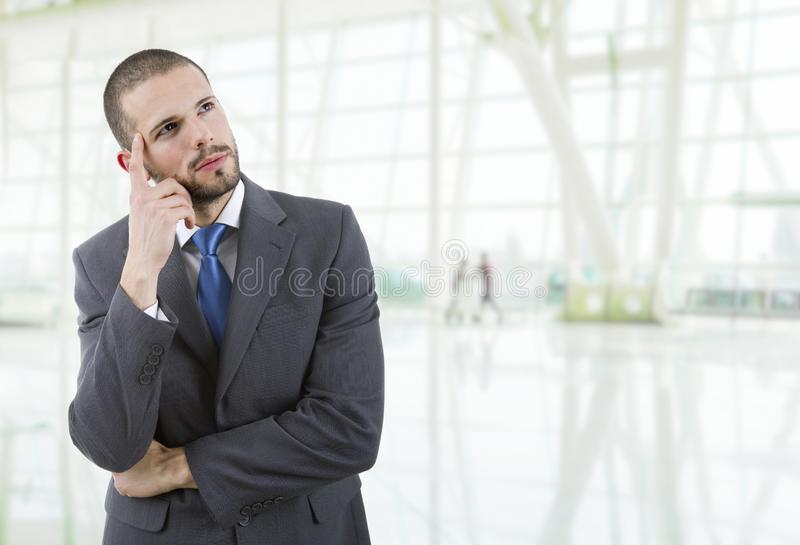 Business man. Young business man thinking at the office stock photo
