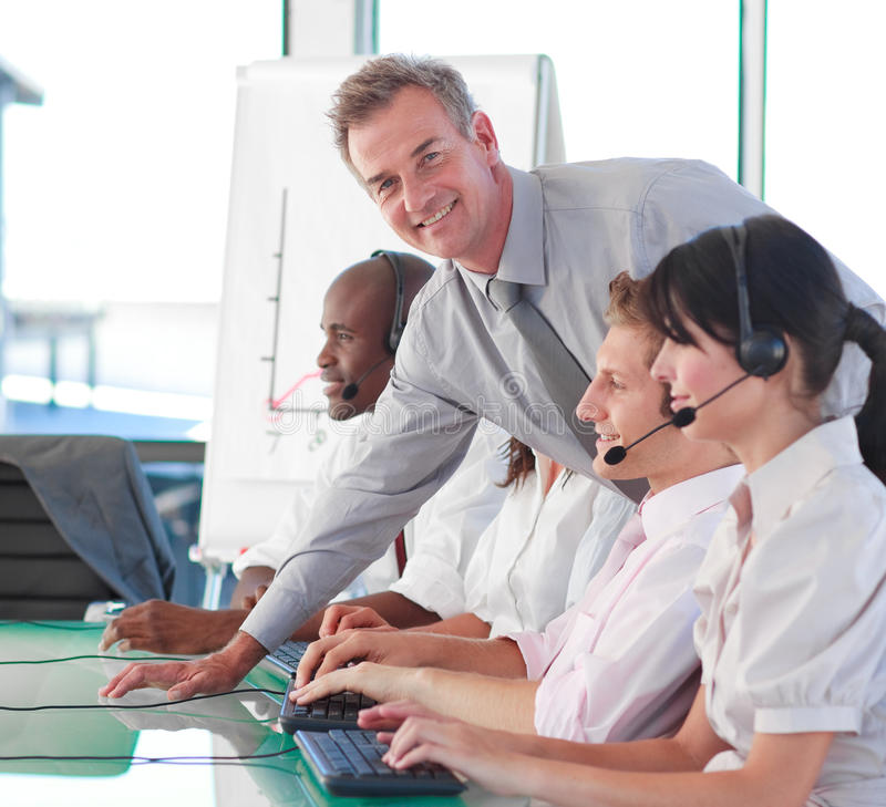 Business manager in a call centre. Senior business manager in a call centre royalty free stock images