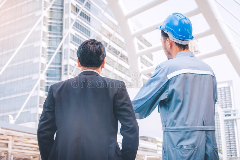 Business manager and engineer meeting project at construction si. Te royalty free stock photo
