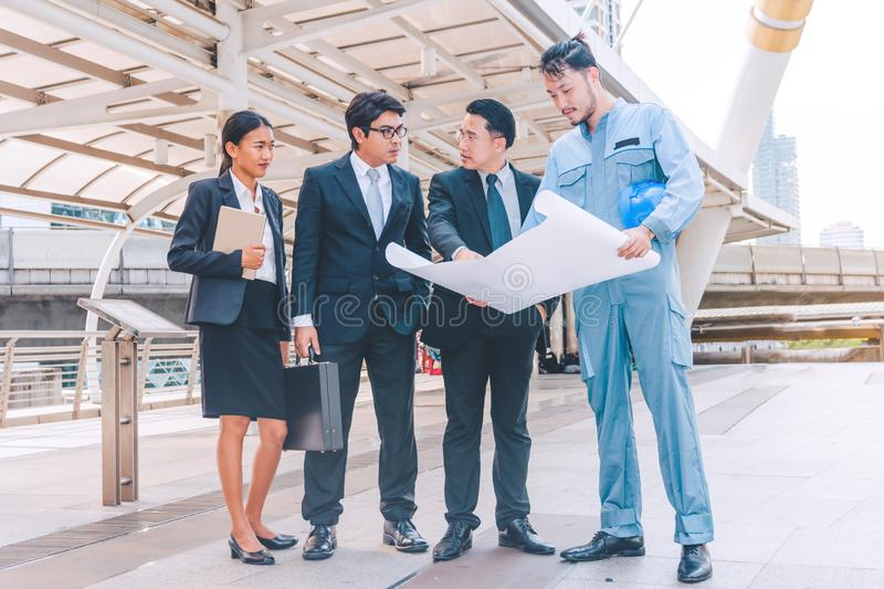 Business manager and engineer meeting project at construction si stock photo