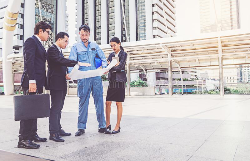 Business manager and engineer meeting project at construction si stock image