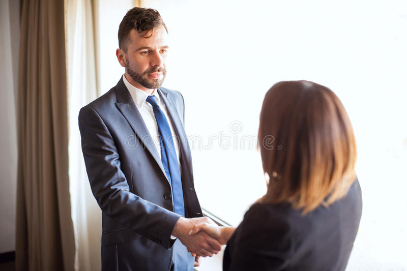 Business manager giving handshake to a client stock photography