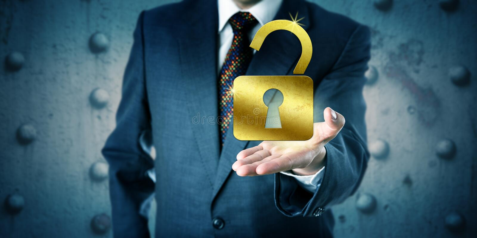 Business Manager Offering A Golden Open Padlock royalty free stock image