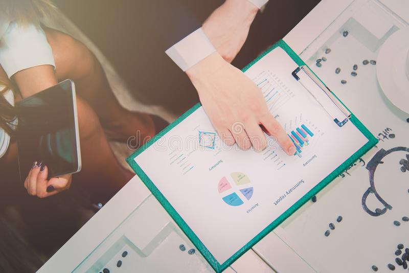 Business manager pointing to summary report and analyze graph plans with team coworker for plan to achieve marketing target,. Meeting and teamwork concept. Soft stock images