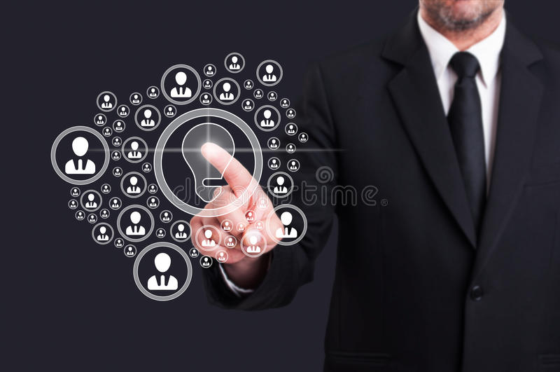 Business manager touching virtual screen with social contacts icon. Business manager touching virtual screen with social contacts and bulb icon as creative idea royalty free stock photos