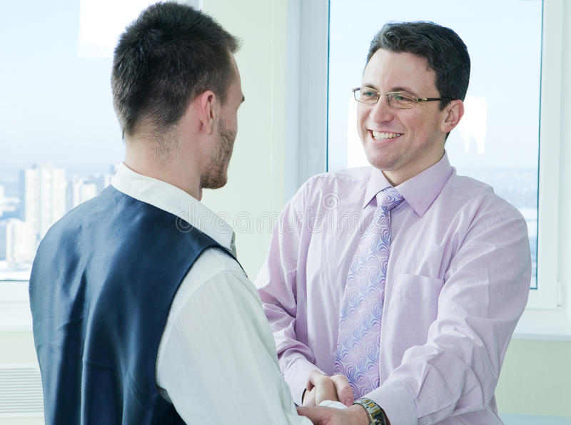 Download Business Mans Have A Lucky Meet With Colleague Stock Photo - Image: 23530970