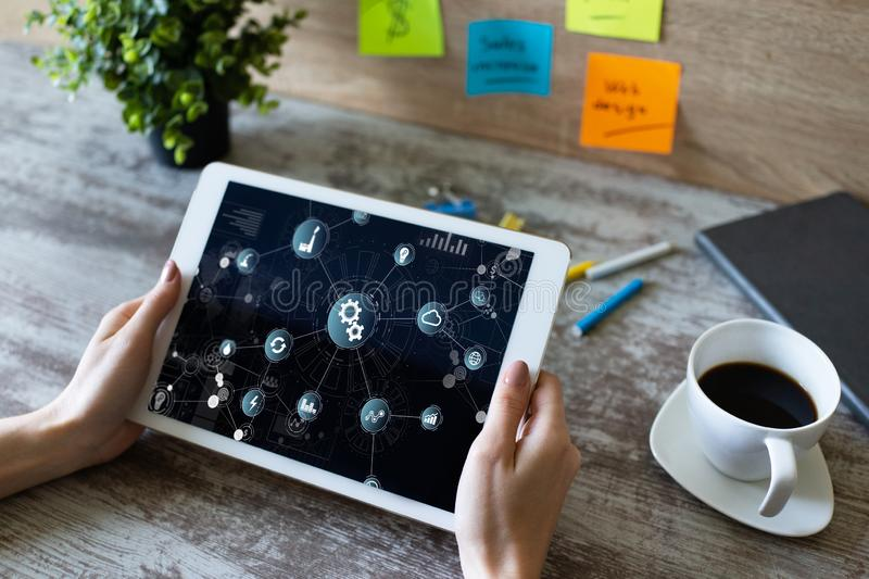 Business and manufacturing process automation concept on device screen. Business and manufacturing process automation concept on device screen stock photo