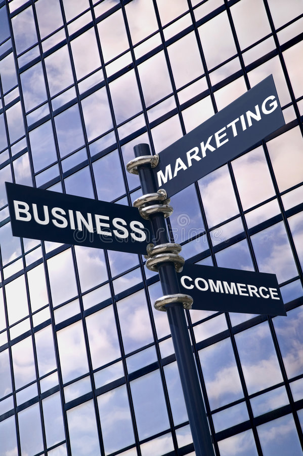 Business Marketing Commerce sign. Concept image of a signpost with Business Marketing and Commerce against a modern glass office building with sky reflection stock photos