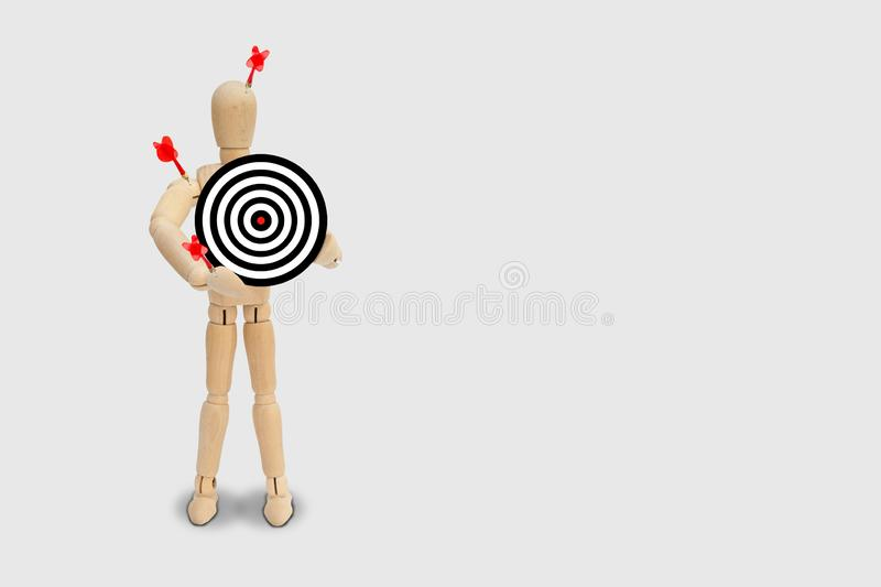 Many red darts missed hit target on dartboard isolated on gray background. Business Marketing Concept : Many red darts missed hit target on dartboard isolated royalty free stock photography