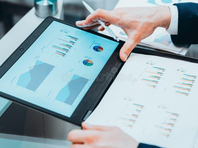 Business marketing study ceo report statistics. Business marketing study. CEO reviewing statistics report on laptop stock photos