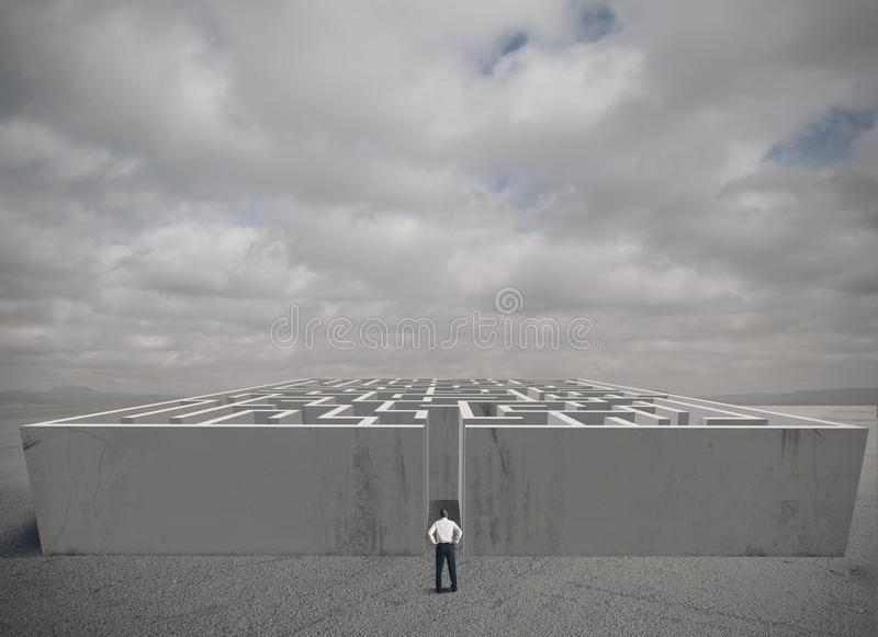 Business maze challenge. Businessman and maze challenge concept royalty free stock photo