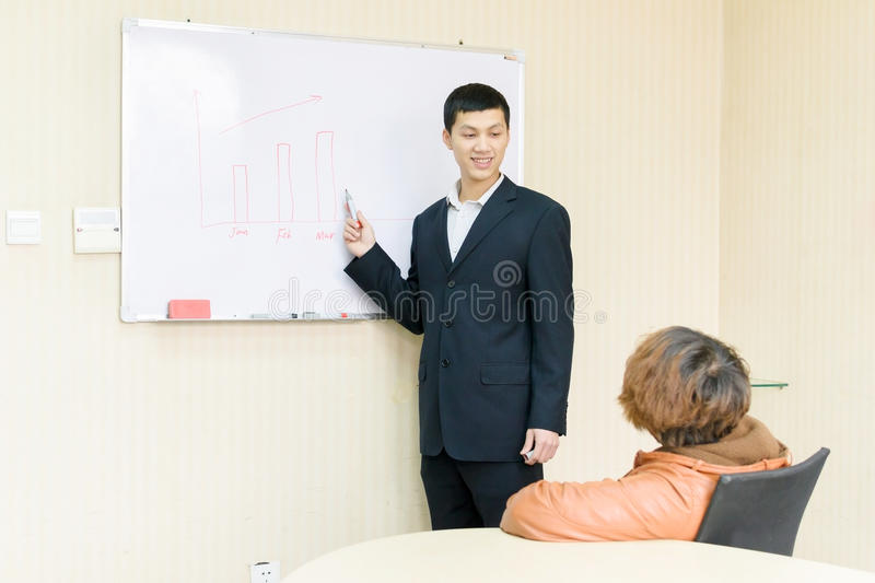 Business meeting. Young people do business in the office room royalty free stock photos