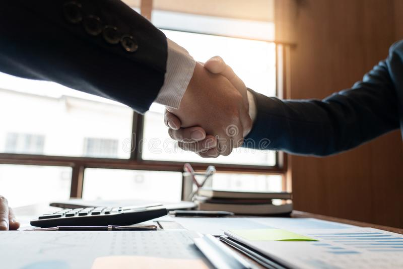 Business Meeting agreement Handshake concept, Hand holding after finishing up dealing project or bargain success at negotiation ov royalty free stock photo