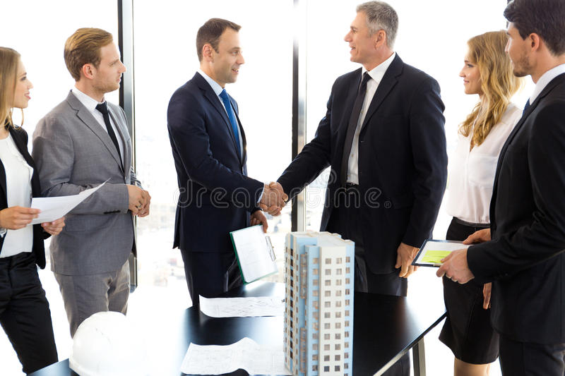 Business meeting of architects and investors stock photos