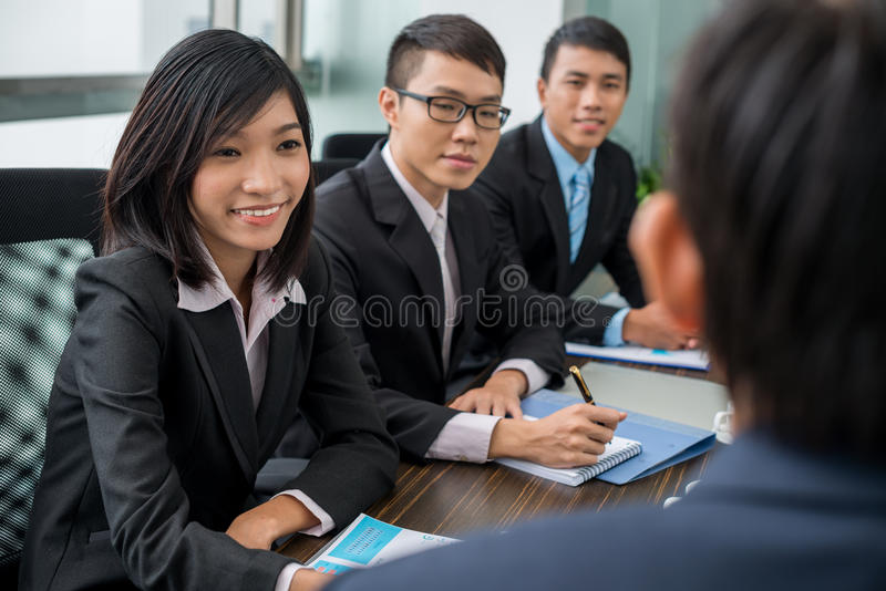 Business meeting. Asian business team having meeting with their chief in the office stock photography