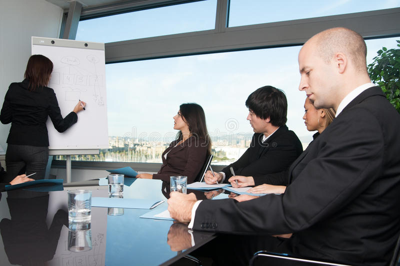 Business meeting in board room with skyline royalty free stock photography