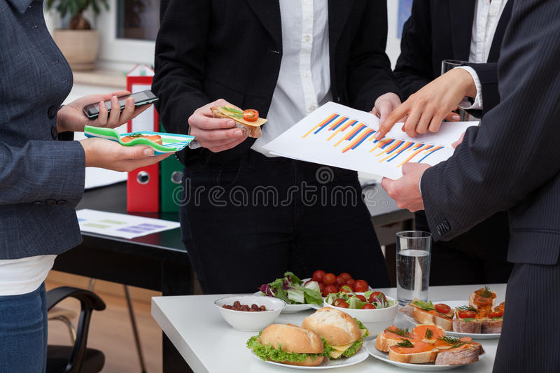 Business meeting at breakfast. With healthy food at office royalty free stock image