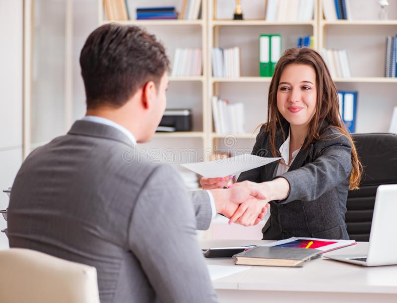Business meeting between businessman and businesswoman royalty free stock image