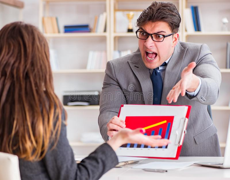 Business meeting between businessman and businesswoman stock photography
