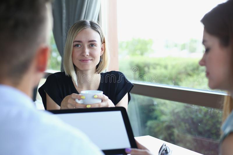 Business meeting in a cafe stock photos