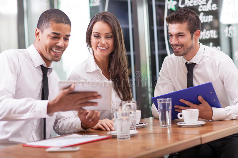 Business meeting in a cafe royalty free stock image
