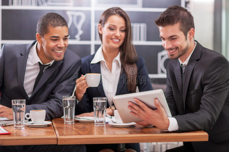 Business meeting in a cafe royalty free stock photo