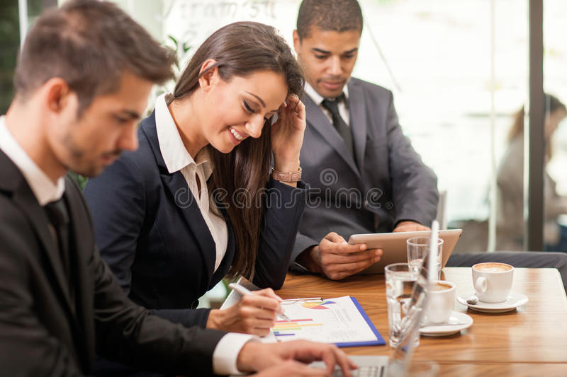 Business meeting in a cafe stock image