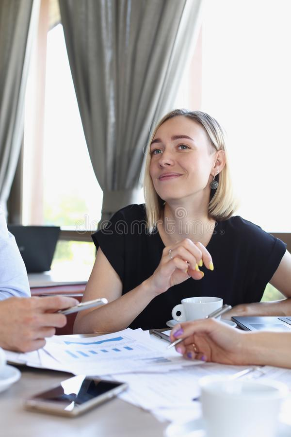 Business meeting in a cafe royalty free stock photography