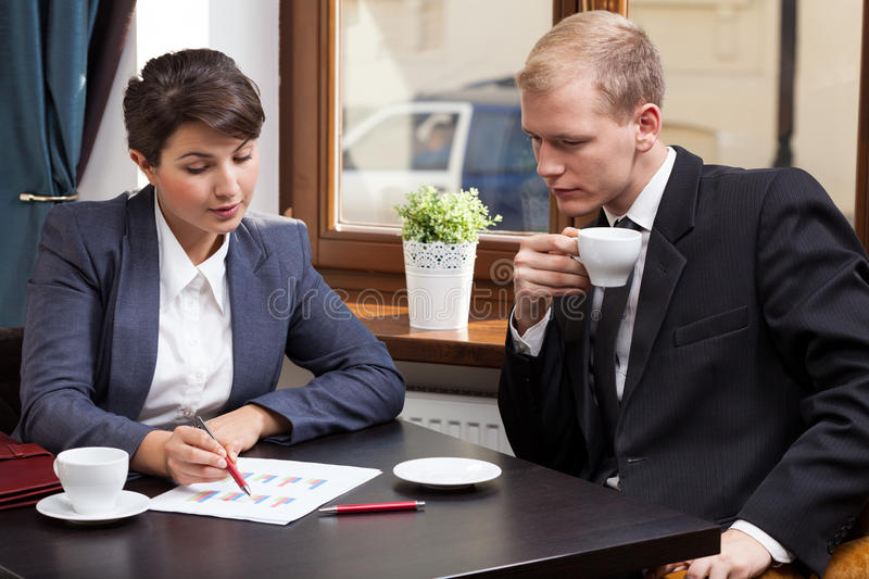 Business meeting in coffeehouse stock photography