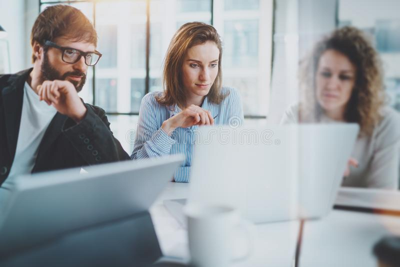 Business meeting concept.Coworkers team working with mobile computer at modern office.Blurred background.Horizontal. royalty free stock photography