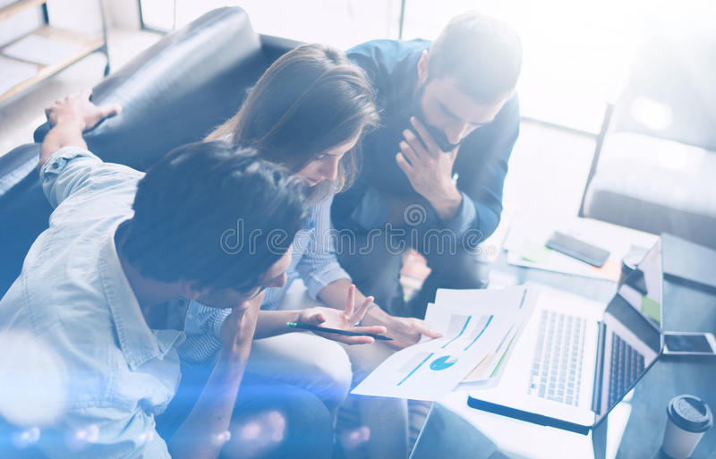 Business meeting concept.Coworkers team working new startup project at modern office.Analyze business documents, laptop royalty free stock photos