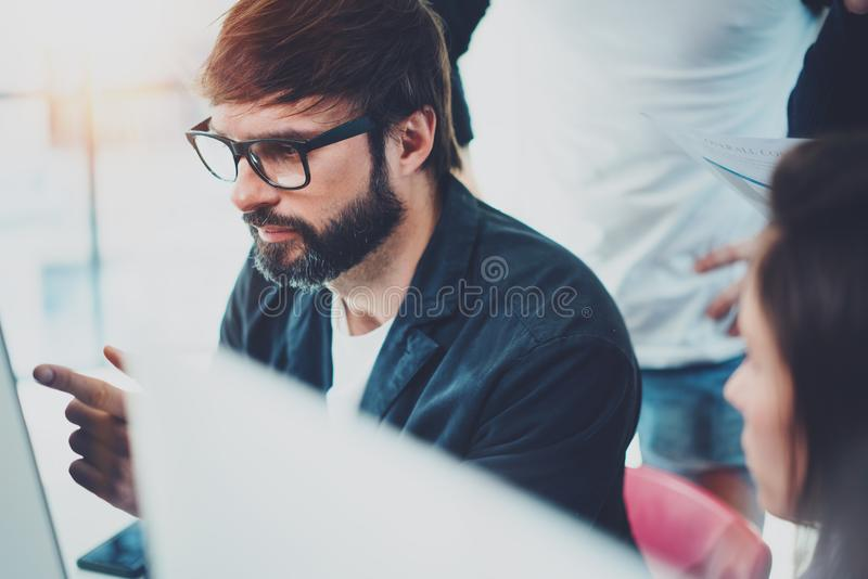 Business meeting concept.Coworkers working with mobile computer at modern office.Blurred background.Horizontal. stock photos