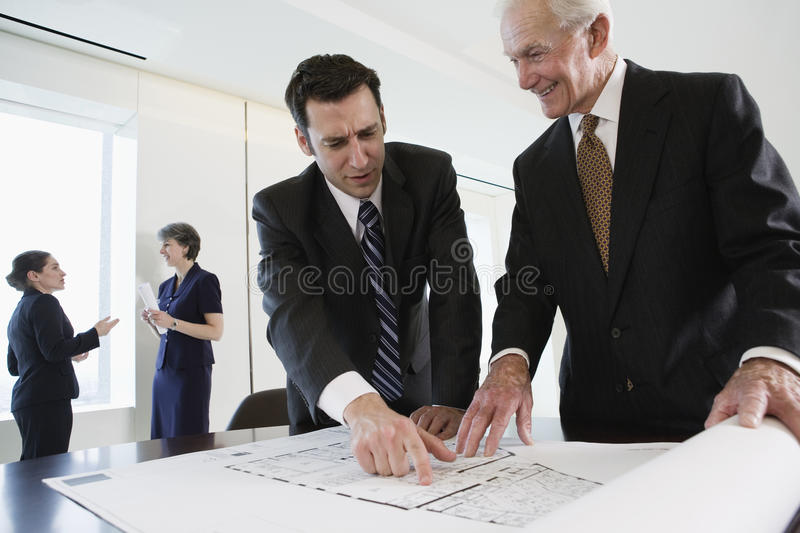 Business meeting discussing plans. stock photography