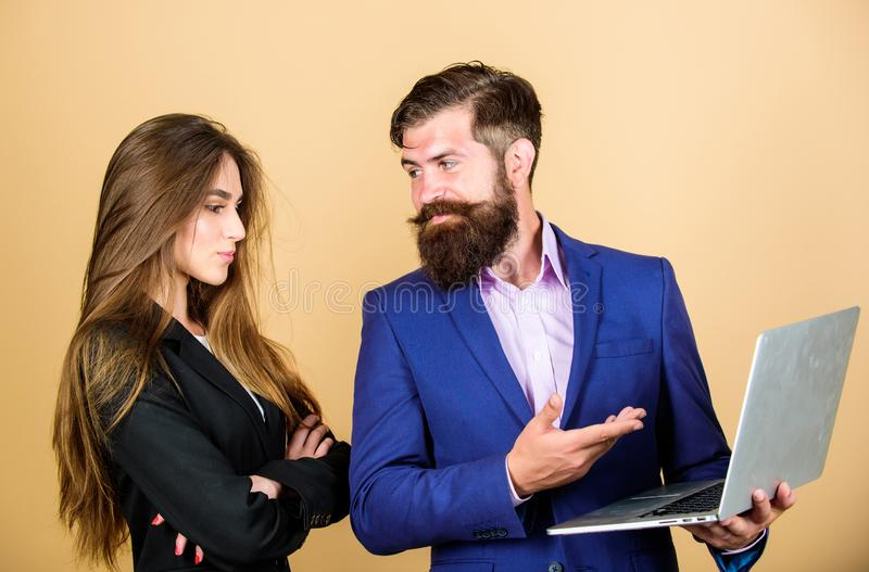 Business meeting. Discussing progress. Man bearded manager show financial report laptop. Woman and guy colleague working royalty free stock image