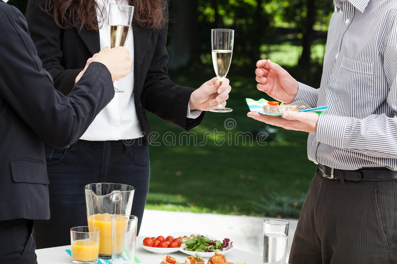 Business meeting in the garden. Business people are celebrating the succes in the garden stock photos