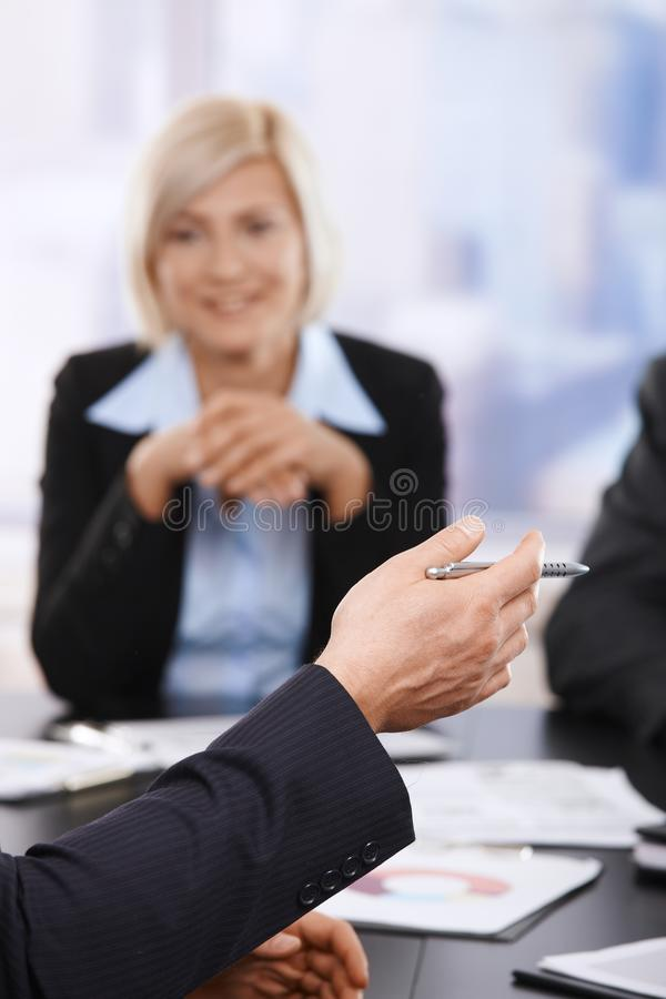 Business meeting, hand with pen in closeup royalty free stock photo