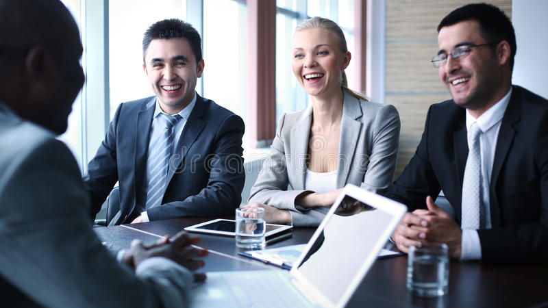 Business meeting. Image of business people interacting at meeting royalty free stock photo