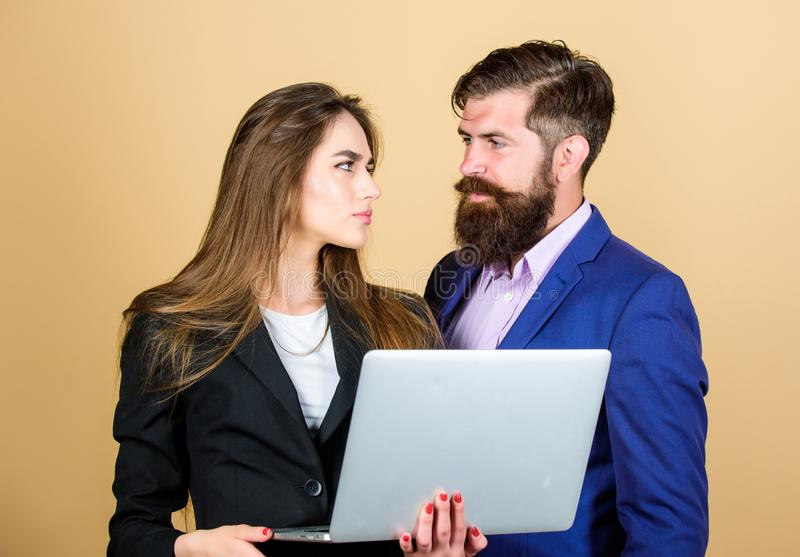 Business meeting. Man bearded manager show financial report laptop. Discussing progress. Woman and guy colleague working stock photography