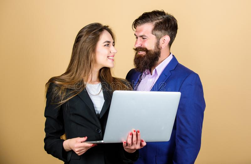 Business meeting. Man bearded manager show financial report laptop. Woman and guy colleague working together. Business stock photo