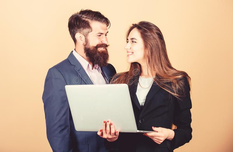 Business meeting. Man bearded manager show financial report laptop. Woman and guy colleague working together. Business royalty free stock photo