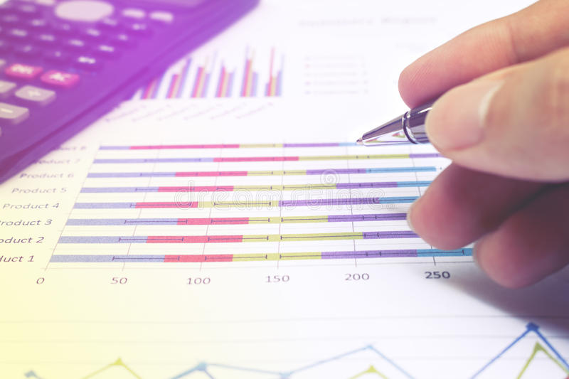 Business meeting, man`s hands pointing on charts. stock photos