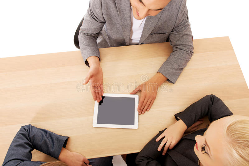 Business meeting-man showing something on tablet royalty free stock image
