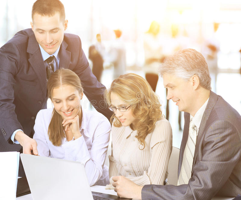 Business meeting - the manager discusses work with his colleagues but the background of the work of the business team stock photo