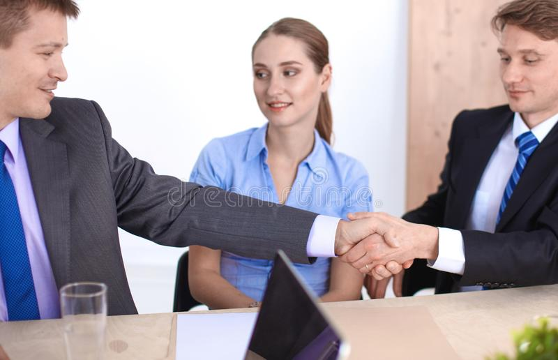 Business meeting - manager discussing work with his colleagues royalty free stock images