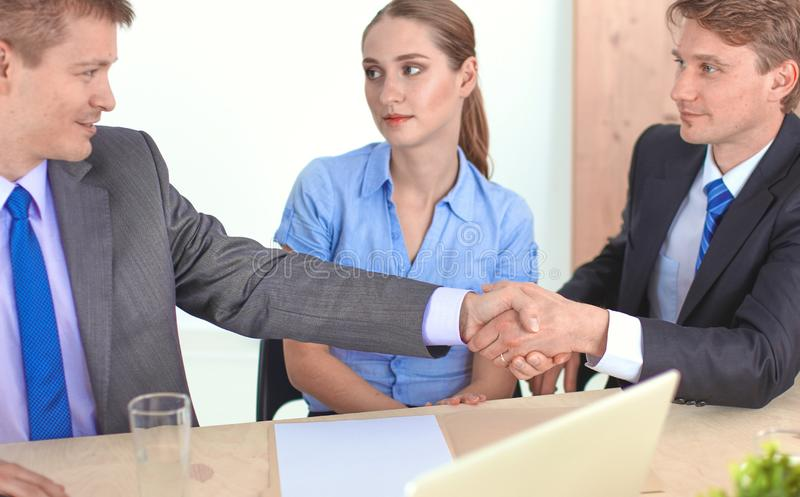 Business meeting - manager discussing work with his colleagues stock photography