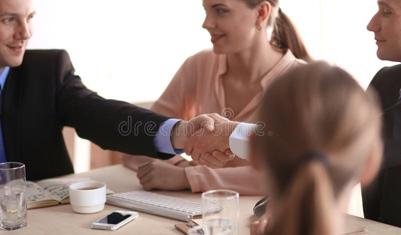 Business meeting - manager discussing work with his colleagues stock photos
